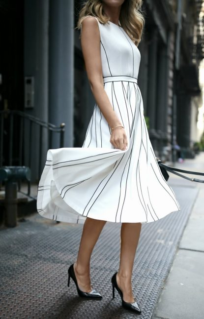 White dress with black trimming